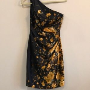 Black, gold and green one strap mid length dress